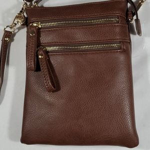 Brown crossbody purse with lots of zipper pockets